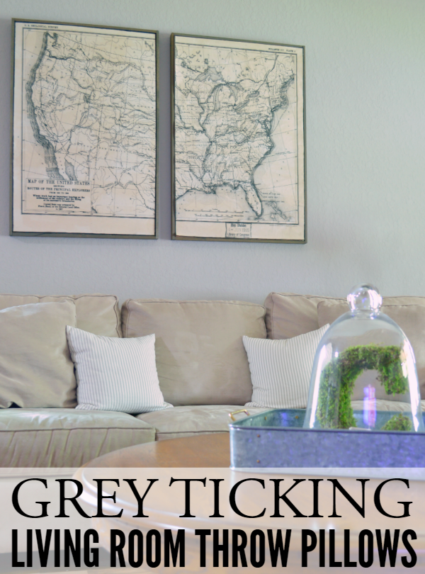 Grey ticking pillows- on couch from afar with graphic